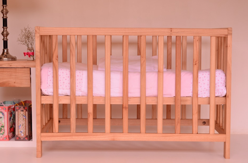 How to save money while buying a baby cot?